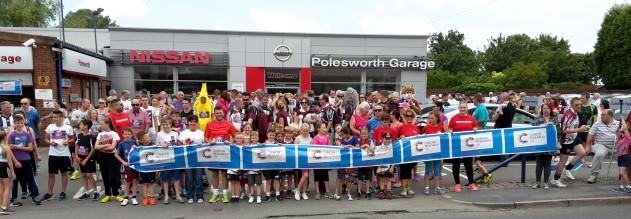 Crowds gather outside Polesworth Garage