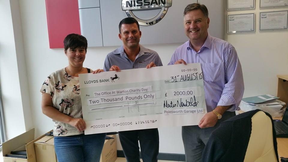 Martin presents £2000 to The Office at Warton Charity fun run.